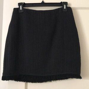 Black woven mini skirt with fringe